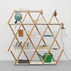 Austrian designer Stephanie Hornig has created an expanding shelving unit which can bunch up or stretch out in any space that it gets placed.