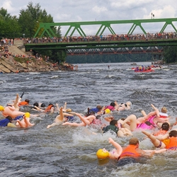 A swim race with inflatable sex dolls in St Petersburg, Russia. [Ed. note - wow i had no idea there were gator ones]