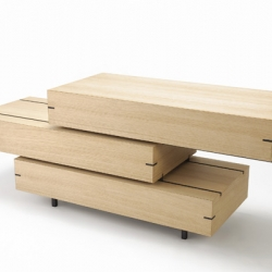 The Drawer Shelf , by Keiji Ashizawa, puts on a amazing display of functionality. It is a series of three drawers that have the ability to independently slide to either side  by using a rail system.