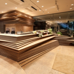 Stacked wooden boards define the interior landscape of Osaka's new Shun*Shoku Lounge designed by Kengo Kuma and Associates.