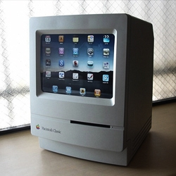 Awesome modding by Hirac of a Mac Classic turned into an Ipad Stand.