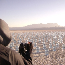 Don't believe it wasn't Photoshopped? Here's the proof: 1,000 water bottles spread out across the Salt Flats in El Paso. Check out the visual diaries for some jaw-dropping shots... by SKAGGS for TOTO.