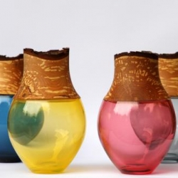 Pia Wusten's handmade small vessels combine the crafts of glass blowing and wood turning.