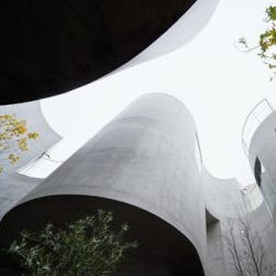 "SANAA's Kazuyo Sejima designs ""her most complex shape so far""--a curvy concrete apartment building with nooks and crannies for semiprivate gardens."