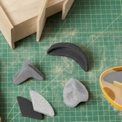 SANDABLES are moldable sand paper blocks that come in different grits and can adapt to difficult shapes (corners, complex curves, etc) previously impossible to achieve.  It was designed by Quirky and its online community.