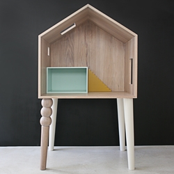 Children or the interaction with them is present throughout the 2014 collection of Sans Souci Atelier. 'Lola' doll house also functions as a desk.
