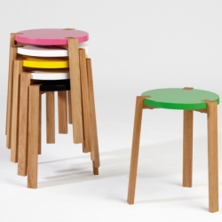 Happy is an adorable little stackable three legged stool. Creative and clean design with an elegant meeting between oak and the top surface. Designed by Swedish design studio A2 Designers.