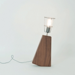 An American black walnut lamp with a dual faceted base for on/off positions designed by Brendan Keim, RISD MFA candidate.
