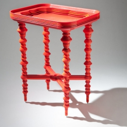 Laser cut plastic cafeteria trays make up this tray table created by RISD Furniture senior Katie Stout.