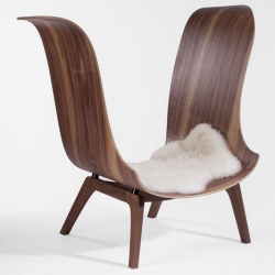With a penchant for fine woodworking, Jason McCloskey's work melds the old and the new in this contemporary wing chair crafted from walnut, poplar, and rubber.
