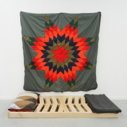 Quilt Sleeping Bag consists of a camp cot crafted from maple wood, with a ripstop nylon, fleece quilt as part of Kate Golden's Senior Thesis Project in RISD's Furniture Department.