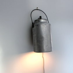 Can Lights are the latest work of RISD designer Sarah Pease. The worn look of the dented aluminum body adds that ever popular rustic feel to any room.