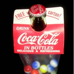 So fun! Marbles as retro bottle topper gifts ~