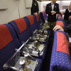 """The Olympic flame sits across six seats on a plane as it is separated into six different miners' lanterns before leaving Athens, Greece, bound for Canada, on Friday,"""