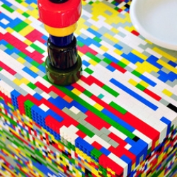 An interior inspired by Legos, complete with a kitchen table covered in lego bricks!