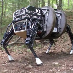 Boston Dynamics and DARPA show improvements made to the Legged Squad Support System. The robot is designed to carry supplies and cargo, autonomously following a soldier.