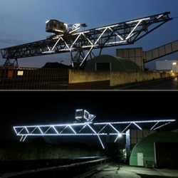 Illuminated coal crane at the docks of Offenbach, Germany by Sebastian Herkner, Peter Eckart and Reinhard Dienes.