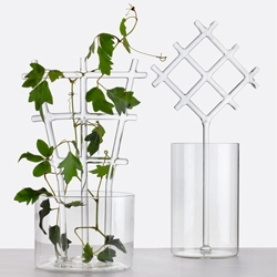 'Bucolic' by 5.5 designers. Vases with trellises for plants to climb. Part of Secondome's hand-blown glass collection launched at Maison & Objet.