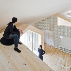 'House K' by Sekkei-sha - The interior is special for its village-like central space – the living area and kitchen – which seems to be surrounded by other residential houses.