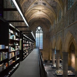 Selexyz Dominicanen bookstore in Maastricht, Netherlands by architects Merkx + Girod is housed in an 800 year old church.  a literary cathedral?