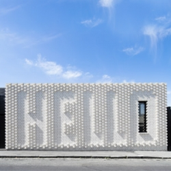 Hello House, large, white-brick wall featuring the word HELLO, by Australian OFF! Architecture in collaboration with artist Rose Nolan, greets the passerby of Richmond, a suburb of Melbourne.