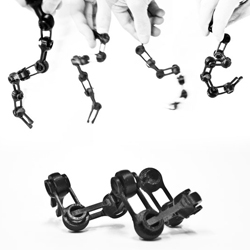 Biased Chains are prototypic chain structures that encode assembly instructions directly into the material parts and demonstrate passive self-assembly.