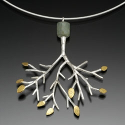 """Sarah Hood's new line of jewelry called """"Arbor"""" is haunting and beautiful, featuring sterling trees adorned with 24k leaves and semi-precious stones, like this pendant with 24k and aquamarine."""