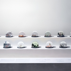 Fourteen snow globes each exploring fourteen scenarios  of the co-existence between Man and 'Nisse' (an elf-like creature appearing in Scandinavian folklores).
