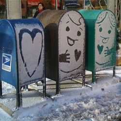 Snow Couple on Mailboxes