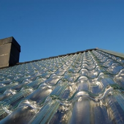 Soltech Energy has unveiled a set of gorgeous solar shingles made from glass!