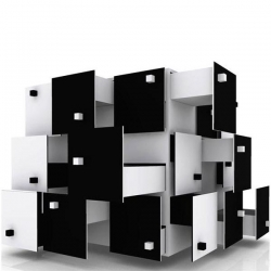 Playfully interactive storage box with randomly placed cubes as handles totaling 36 drawers in varying lengths,shaped like a puzzle, design its very creative and innovative. Solo by Franck Tawema.