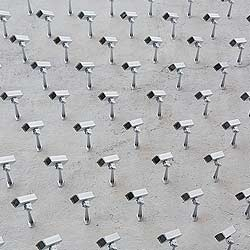 Installation of 150 fake security cameras on building facade with the intention of not watching over anything, by urban artist SpY