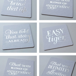 Tipsy tips on coasters from Spoolia Design.  Each bit of advice has been hand lettered with love and letterpressed in silver foil.