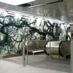 This complex NYC subway commission, three years in the making, features curved glass walls laced with silhouettes of trees, a marble mosaic topographic map of Manhattan, and imagery from nearby Battery Park.