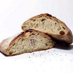 The magazine Stiletto asked master baker Eric Kayser  to create the most precious bread of the world with jeweler Mauboussin. There are 7 carats hidden in this loaf.