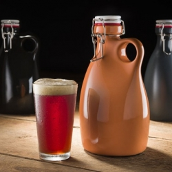 Orange Vessel Stoneware Growlers, wider mouth than most other options, makes pouring in and out much easier.