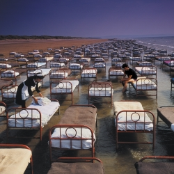 700 actual, real-life beds on a beach in Devon. Created by Storm Thorgerson for the cover of Pink Floyd's album A Momentary Lapse of Reason. Part of Idea Generation Gallery's Storm retrospective - launching April 2nd, London.