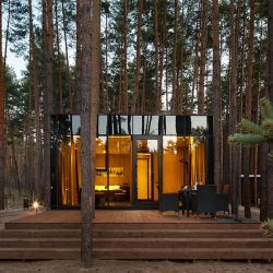 Somewhere between The Black Sea and Russia, you will find Sosnovka's Relax Park Verholy. Here, amidst a maze of trunks and needled ground, Studio YOD has crafted guest houses seemingly born from the forest.
