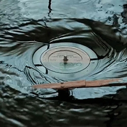 Submerged Turntable installation by artist Evan Holm. A turntable that works even while submerged underwater.