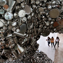 New Delhi-based artist Subodh Gupta creates large-scale sculptures using everyday Indian metal cups, bowls and utensils.