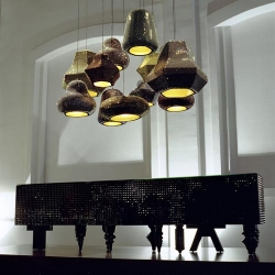 A new form of chandeliers designed by Hayon Studio combine several types and sizes to collect from the beauty of modern securities Swarovski crystals.
