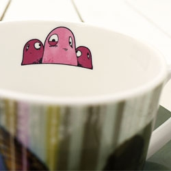 Beautiful new limited edition Cup and Saucer from popular UK artist Tom Lewis ... 'Megan V's the triple ripple'.