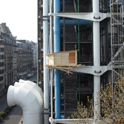 Tadashi Kawamata's newest creation is wooden huts hanging like wasp's nests between the beams and pillars of the structural facade of Centre Pompidou in Paris.