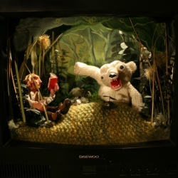 Danielle Buerli's creates dramatic scenes with his original toys and mini-set designs.