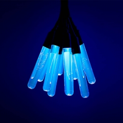 Tonic Lamp was designed and built by Germán González Garrido using Tonic Water,  Test Tubes and UV LEDs. The structure of the quinine molecule radiate energy in the form of visible blue light.