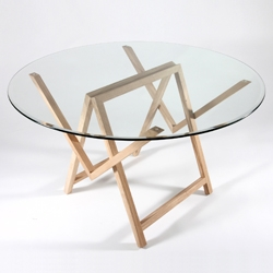 A trestle glass table that folds up.  Designed by Bénédicte de Lescure for La Corbeille Editions.