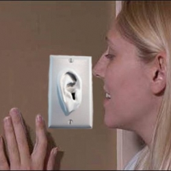 """Blow in the ear to turn on the light- """"Turn Me On"""" switch plate from Chris Haines."""