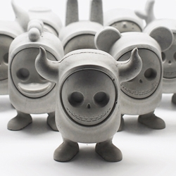 UM: United Monsters are art toys made of concrete.