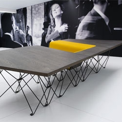 SitTable from UNStudio combines a chair and table into a single streamlined piece of furniture.