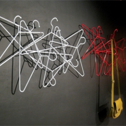 """Hangers"" is a wall coat rack made from mild steel hangers."
